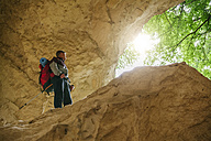 Serbia, Rakovac, young man hiking, cave, abandoned quarry - ZEDF000175