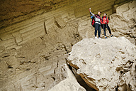 Serbia, Rakovac, young couple hiking, selfie in cave, abandoned quarry - ZEDF000178