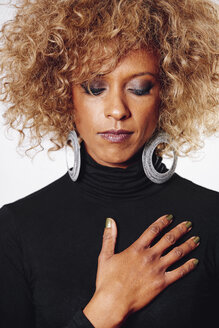 Portrait of rouged woman with afro wearing black turtleneck pullover - JCF000003