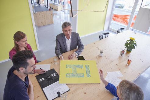 Business people having a meeting in board room - RHF001483