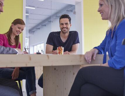 Business people having a meeting in board room - RHF001516