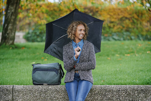 Portrait of smiling woman with umbrella - JCF000022