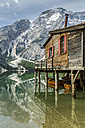 Italy, South Tyrol, Dolomites, Fanes-Sennes-Prags Nature Park, Lake Prags with Seekofel, boathouse - STSF001013