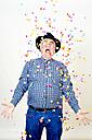Portrait of senior man watching falling confetti - JCF000041