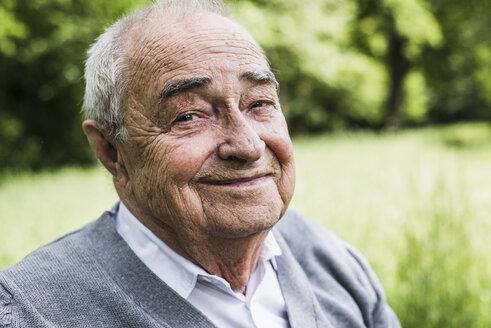 Portrait of smiling senior in nature - UUF007577