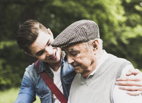 Senior man and his grandson in nature - UUF007592