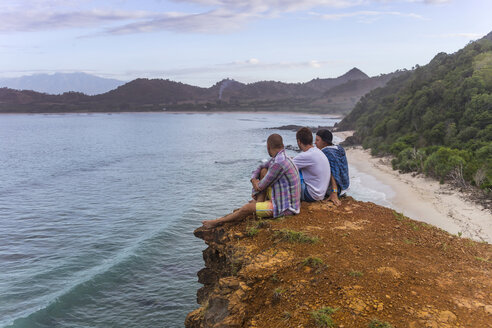 Indonesia, Sumbawa island, Young people sitting on viewpoint - KNTF000298