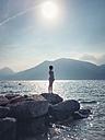 Italy, Brenzone, girl at Lake Garda - LVF004920