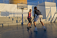 Couple playing basketball on a deck of a cruise ship - ONBF000044
