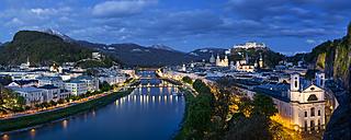 Austria, Salzburg, panoramic view of Salzach river, old town and castle Hohensalzburg, blue hour - YRF000105