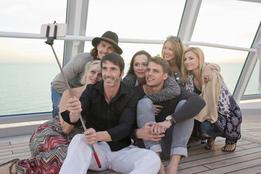 Group of friends taking selfies on a cruise - ONBF000052