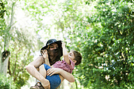 Playful mother and son outdoors - VABF000553