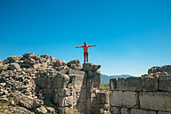 Bosnia and Herzegovina, Stolac, Ancient, Ruins, young man with extended arms - ZEDF000187