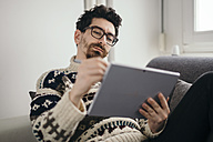 Portrait of man drawing something on digital tablet - LCUF000025