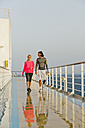 Couple walking in the morning light on a shipdeck, cruise ship, Mediterranean Sea - ONBF000056