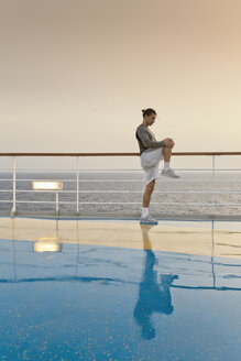 Young man doing exercises on a shipdeck, cruise ship, Mediteranean Sea - ONBF000064