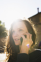 Portrait of smiling woman telephoning with smartphone - BOYF000402