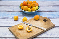 Sliced and whole apricot on wooden board - LVF004931