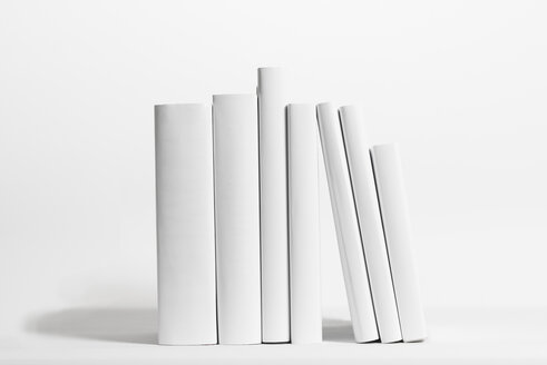 Seven white books in front of white background - SKAF000012