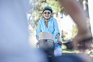 Smiling elderly woman on bicycle - ZEF008696