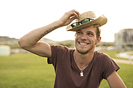 Blond man with hat in a park, portrait - JASF000836