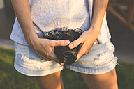 Woman with vintage camera - KNTF000326