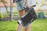 Woman with vintage camera - KNTF000332