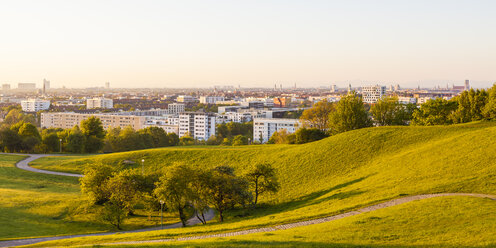 Germany, Munich, view to cityscape with park in the foreground - WDF003628