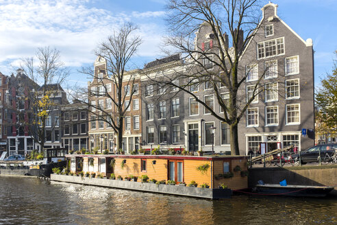 Netherlands, County of Holland, Amsterdam, View of a houseboat during the fall - JLRF000061