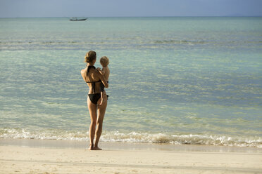 Thailand, mother and son standing on beach - SBOF000032