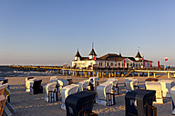 Germany, Usedom Island, Ahlbeck, sea bridge and beach chairs - KLRF000371