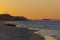 Germany, Usedom Island, Ahlbeck, sunset at the beach - KLRF000374