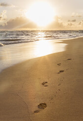 Dominican Rebublic, footprints in sand at tropical beach at sunset - HSIF000456