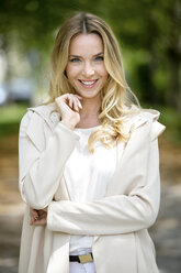 Portrait of smiling blond woman - GDF001007