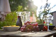 Mediterranean antipasti and wine on garden table - SARF002761