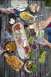 People enjoying variety of Mediterranean antipasti - SARF002764