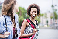 Portrait of smiling woman looking at her friend - UUF007675