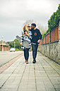 Couple in love with skateboard walking on pavement - DAPF000120