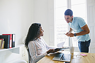 Young businessman and woman working together in office - EBSF001497