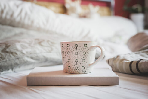 Book and cup of coffee on a bed - ASCF000620