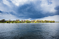 Germany, North Rhine-Westphalia, Rhine riverbank and stormy atmosphere - SKAF000013