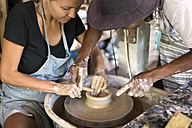 Man and woman in workshop working on pottery - KNTF000355