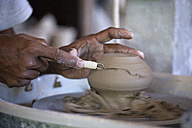 Man in workshop working on pottery - KNTF000364