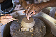 Man and woman in workshop working on pottery - KNTF000367