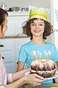 Girl receiving birthday cake - NHF001497