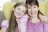Portrait of smiling mother and daughter - NHF001509