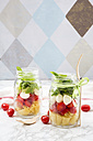 Calabrese salad with pasta, tomatoes, mozzarella, rocket and basil in glasses - LVF004954