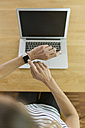 Woman with smartwatch and laptop - SBOF000080