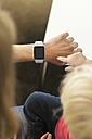 Mother showing smartwatch to little son - SBOF000101