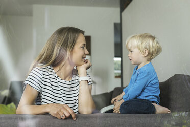 Mother and son on couch facing each other - SBOF000104